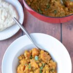 Delicious Moroccan lentil stew served in a wgite bowl and ready to eat!
