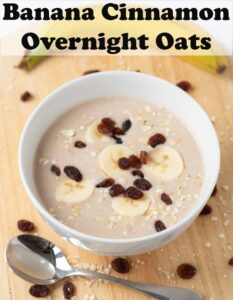 A bowl of banana cinnamon overnight oats topped with slices bananas and raisins. A spoon at the foot. Pin title text overlay at top.
