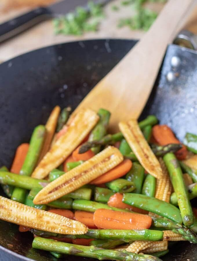 Picture showing this delicious healthy spring stir-fry vegetables recipe finished cooking in a wok and ready to serve.