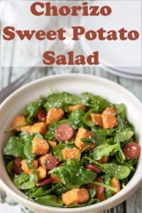 A large bowl of chorizo and sweet potato salad ready to serve. Pin title text overlay at top.