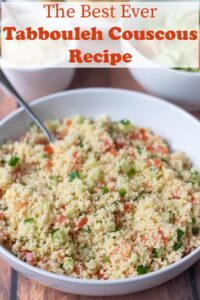 Large bowl of tabbouleh couscous with serving spoon placed in it.