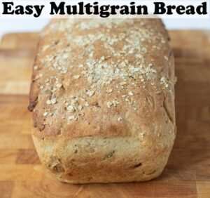 A loaf of easy multigrain bread. Pin title text overlay at top.