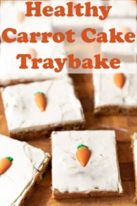 Healthy carrot cake traybake slices on a chopping board. Pin title text overlay at top.