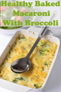 Healthy baked macaroni with broccoli served from the oven with a spoon on top.