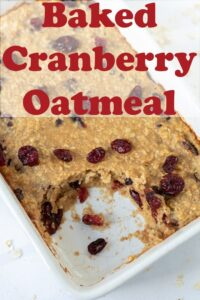 Baked cranberry oatmeal in a baking dish with a serving taken out. Pin title text overlay at top.