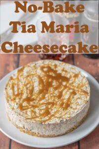 No-bake Tia Maria cheesecake on a plate. Pin title text overlay at top.