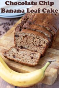Chocolate chip banana loaf cake on a bread board with 4 slices cut off. A banana at the front. Pin title text overlay at top.