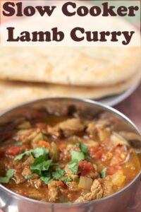 A serving of slow cooker lamb curry in a balti dish. Pin title text overlay at top.