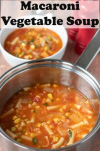 A pot of macaroni vegetable soup with a bowl of soup in the background. Pin title at top.