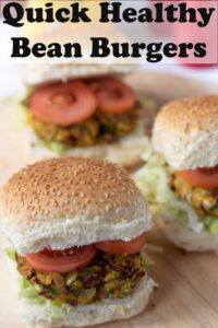 Three quick healthy kidney bean burgers in burger buns on a beds of iceberg lettuce and topped with sliced tomatoes. Pin title text overlay at top.