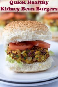 A quick healthy kidney bean burger on a bun with sliced tomatoes. Pin title text overlay at top.