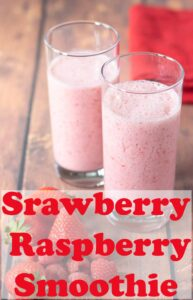 Two glasses of strawberry and raspberry smoothie with a red napkin in the background. Pin title text overlay at the bottom.