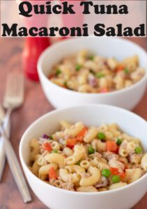 Two bowls of tuna macaroni salad one in front of the other. Pin title text overlay at top.