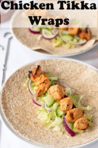 Two chicken tikka wraps ready to be rolled up. Pin title text overlay at top.