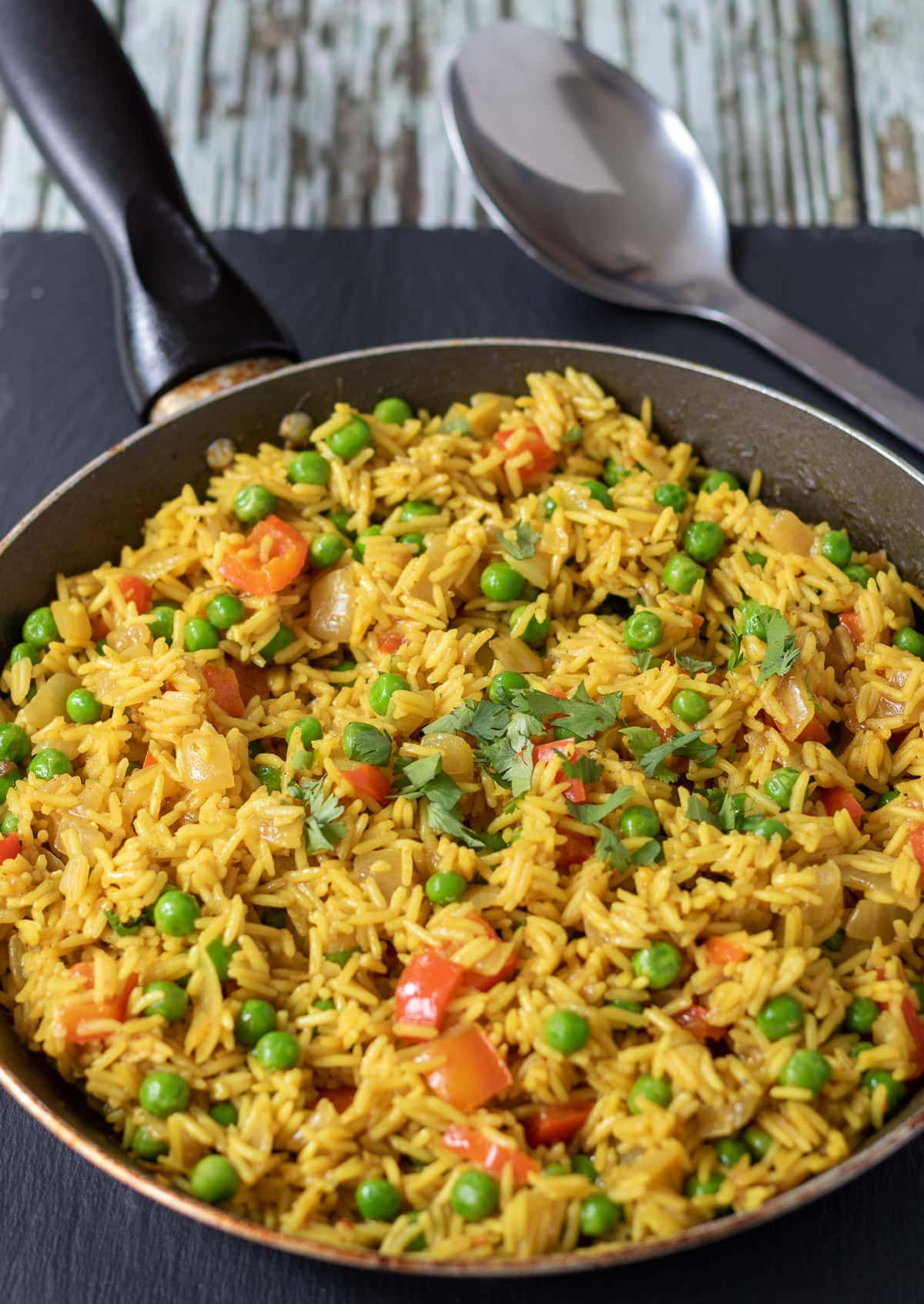 A pan of served spicy rice with peas.