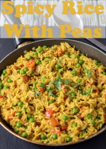 A pan of cooked spicy rice with peas. Pin title text overlay at top.