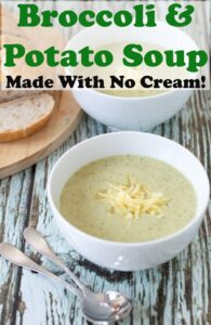 A bowl of broccoli and potato soup topped with grated cheddar cheese and soup spoons in front. Pin title text overlay at top.