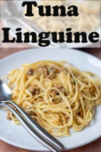 A plate of tuna linguine with a fork and spoon to the left hand side. Pin title text overlay at top.