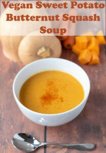 A bowl of sweet potato and butternut squash soup. Soup spoon in front. Pin title text overlay at top.