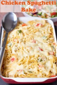 Chicken spaghetti bake in a casserole dish with a serving spoon beside. Pin title text overlay at top.