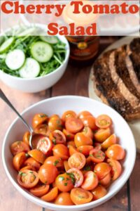 A bowl of cherry tomato salad with a small bowl of cucumber above and a plate of sliced toasted bread to the right. Pin title text overlay at top.