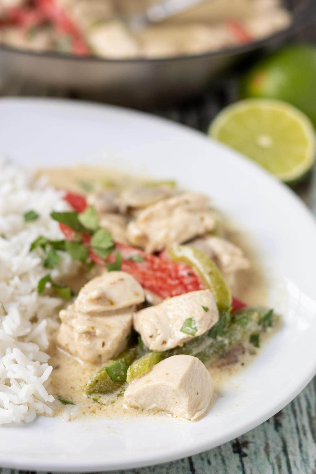 A plate of easy Thai green chicken curry served with basmati rice.