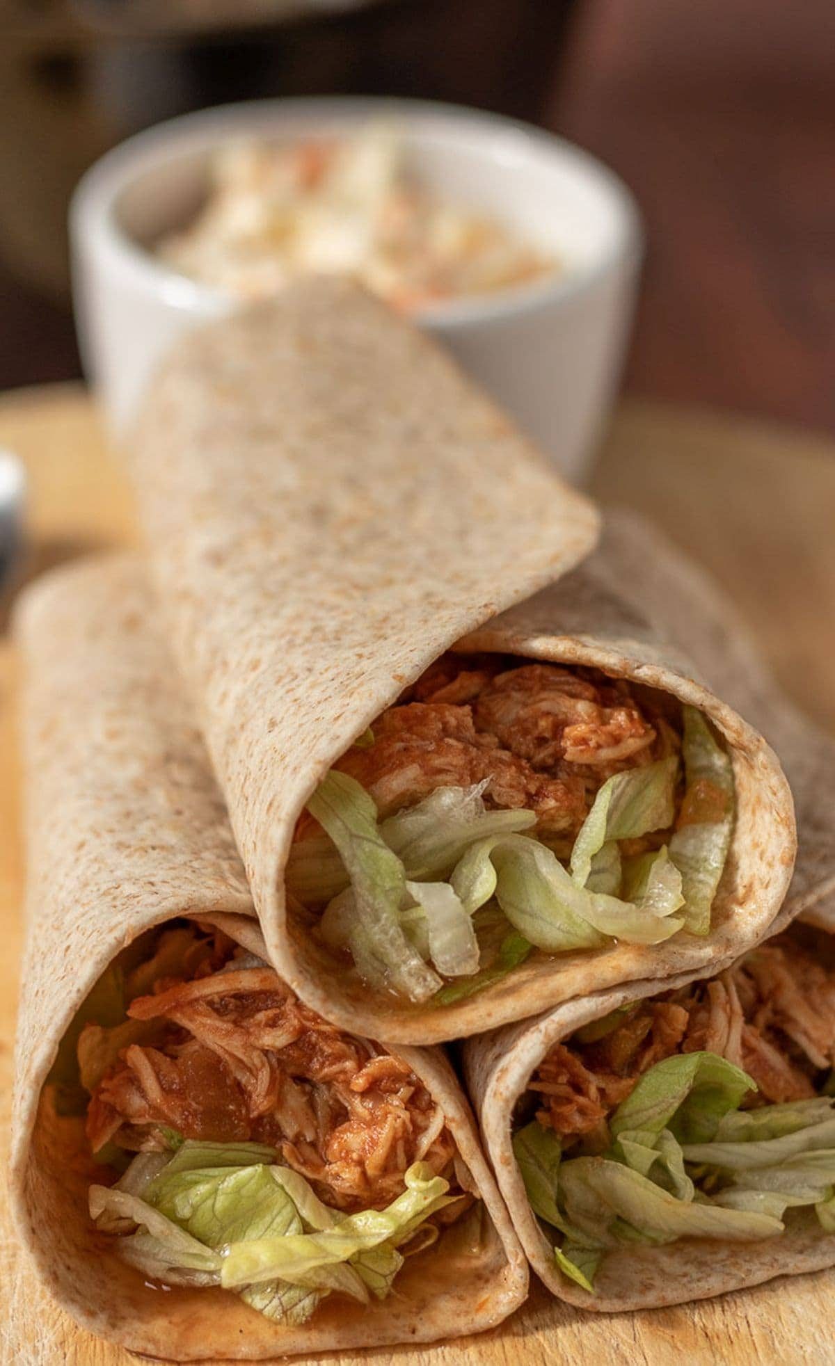 Close up of shredded BBQ chicken wraps.